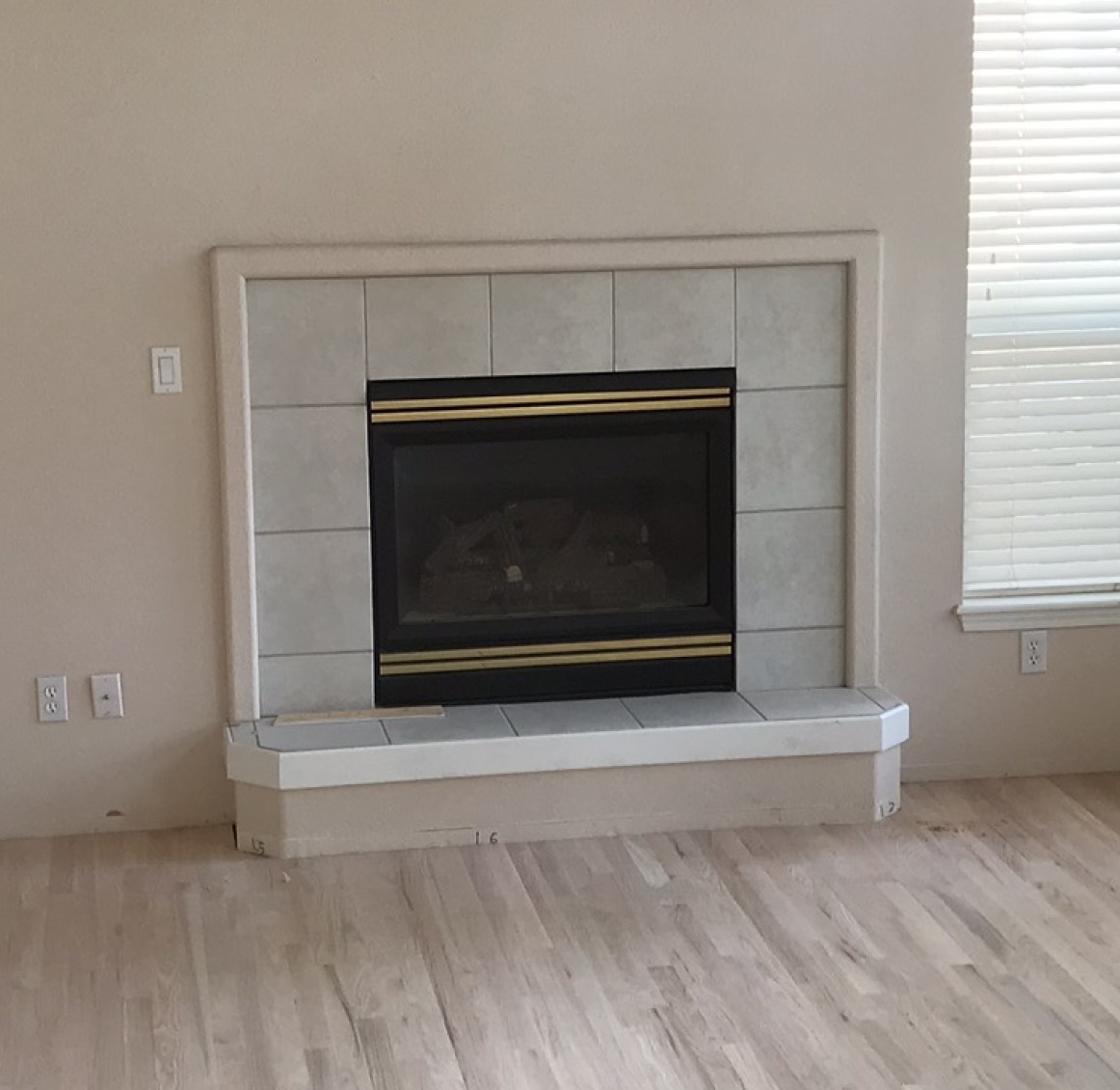 Before brass fireplace makeover
