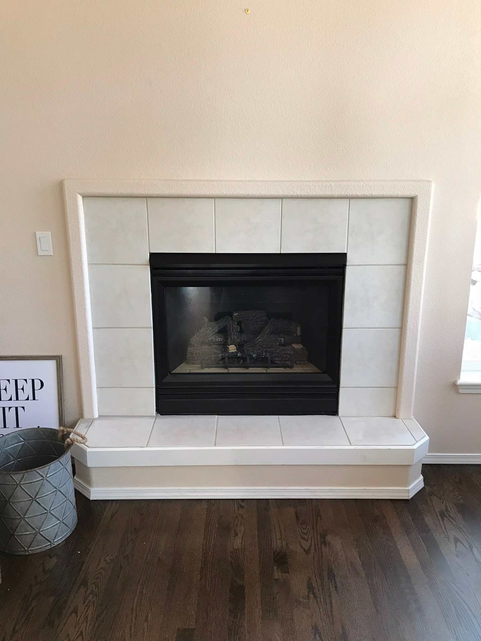 Painted over brass black fireplace