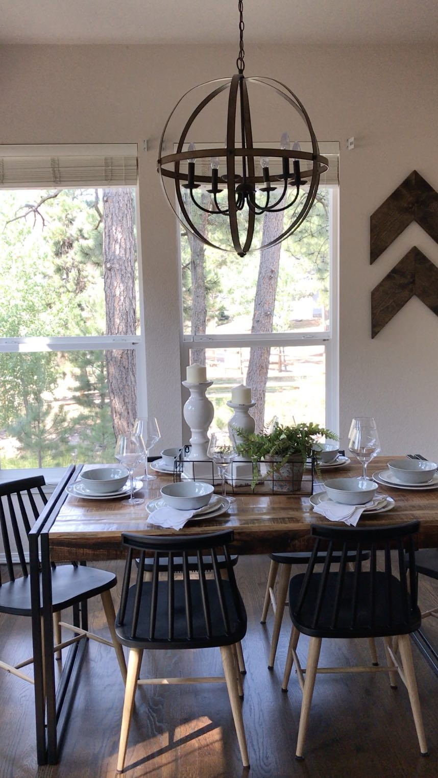 I LOVE this modern farmhouse style light fixture! Made my kitchen look so good